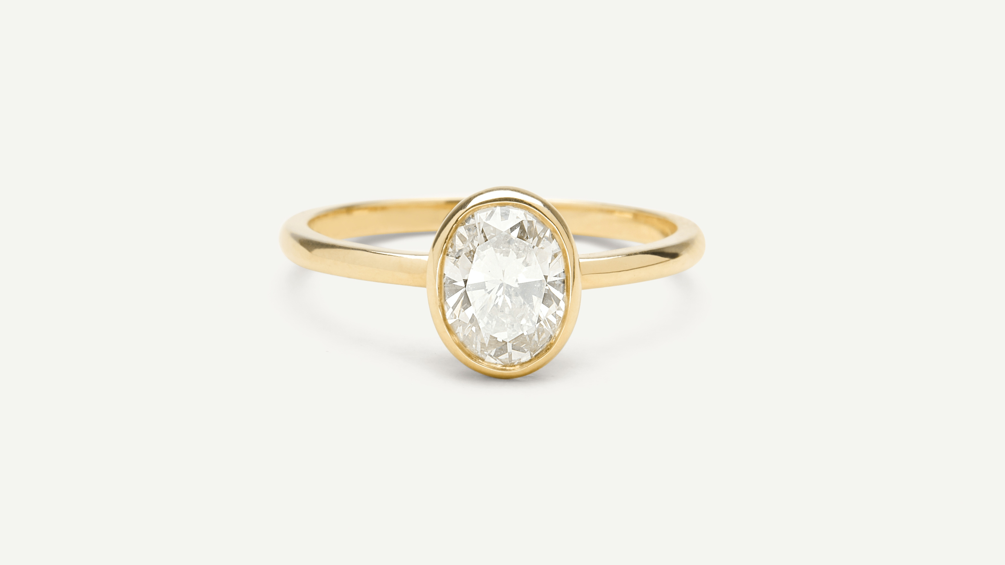 Oval Bezel Diamond Engagement Ring By Vrai Oro